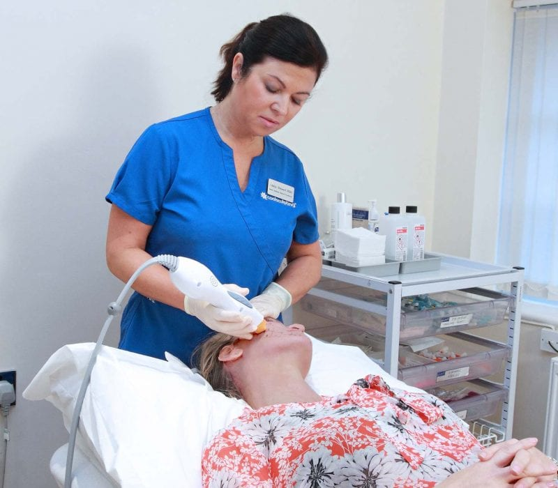 A lady undergoing thermage treatment to the face